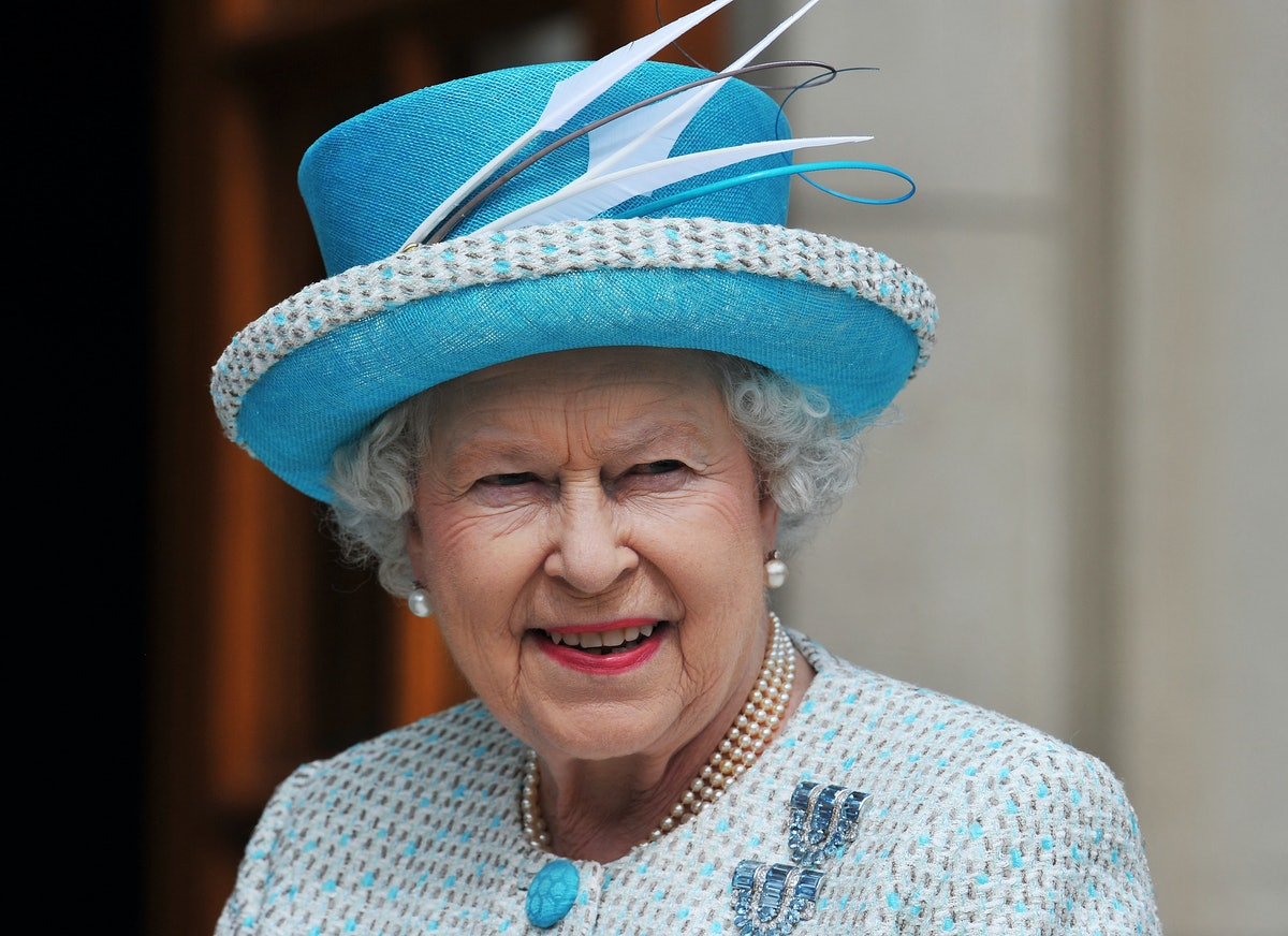 Britain's Queen Elizabeth II arrives to meet Irish Prime Minister Enda Kenny at the Government Build...