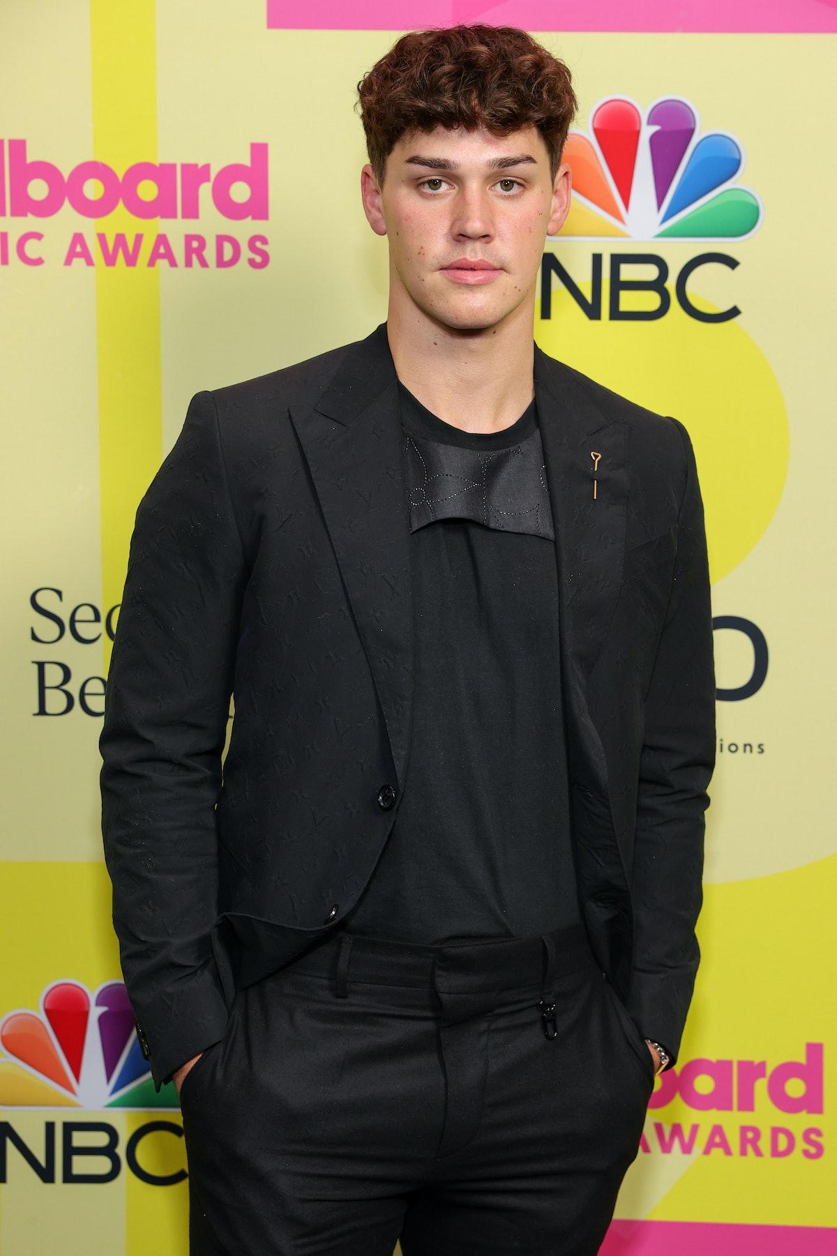 LOS ANGELES, CALIFORNIA - MAY 23: Noah Beck poses backstage for the 2021 Billboard Music Awards, bro...