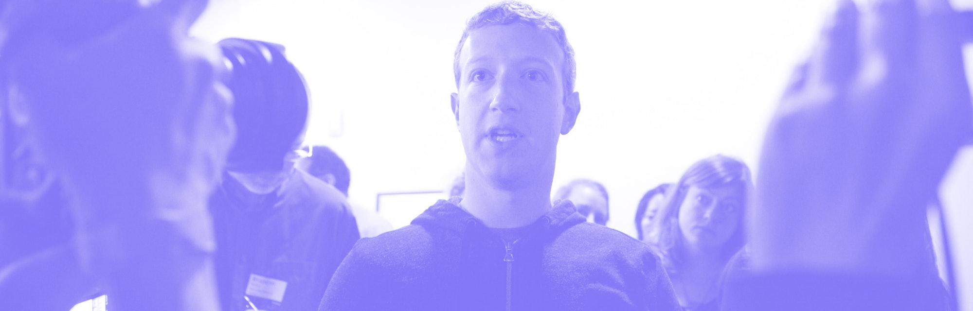 Mark Zuckerberg (center) speaks to a media after a press conference where a redesign of  Facebook's ...