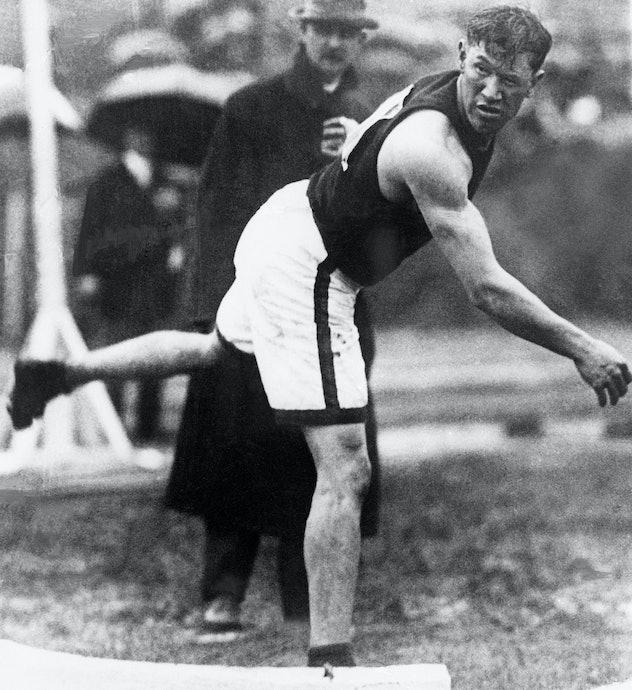 (Original Caption) 1912-Stockholm, Sweden: Jim Thorpe throws the shot put during the 1912 Olympic Ga...
