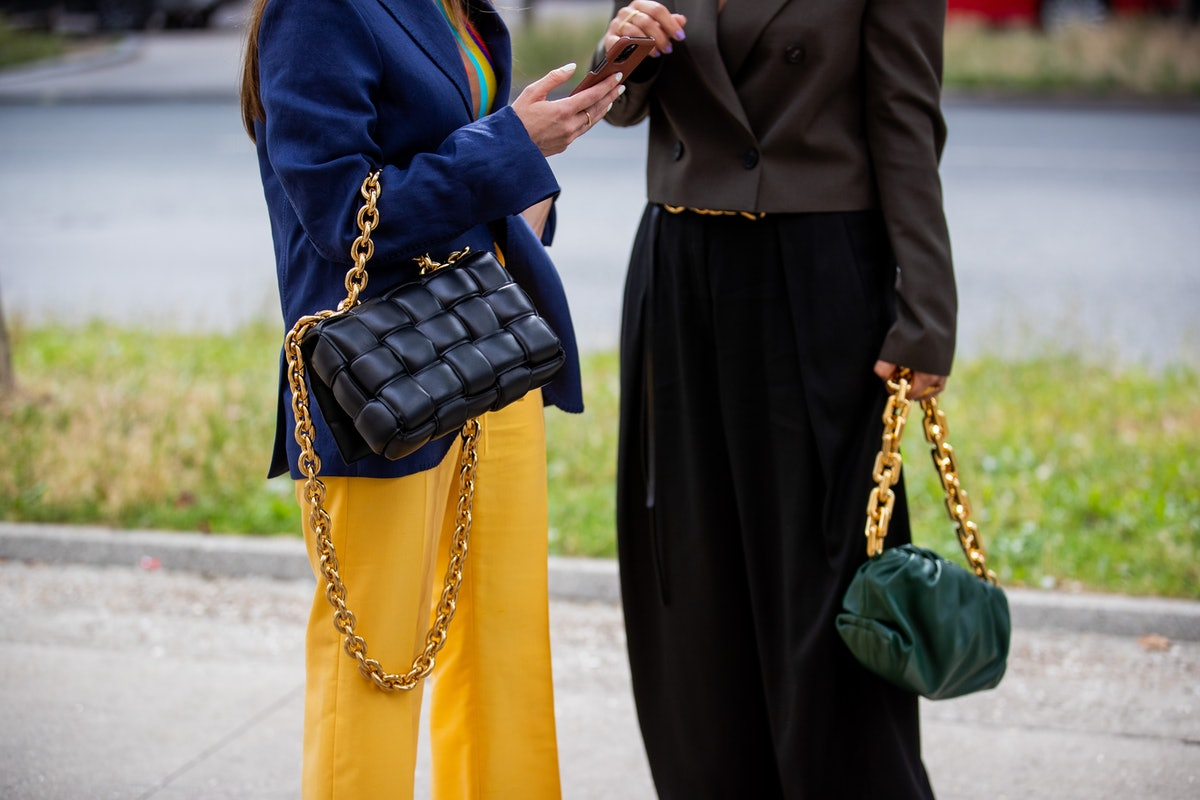 PARIS, FRANCE - JULY 08: Julia Comil is seen wearing Bottega Veneta bag, blue blazer, yellow pants a...