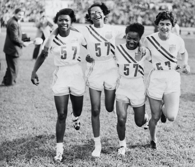 (Original Caption) 7/27/1952-Helsinki, Finland- Members of the U.S. Women's 400 meter relay team cav...