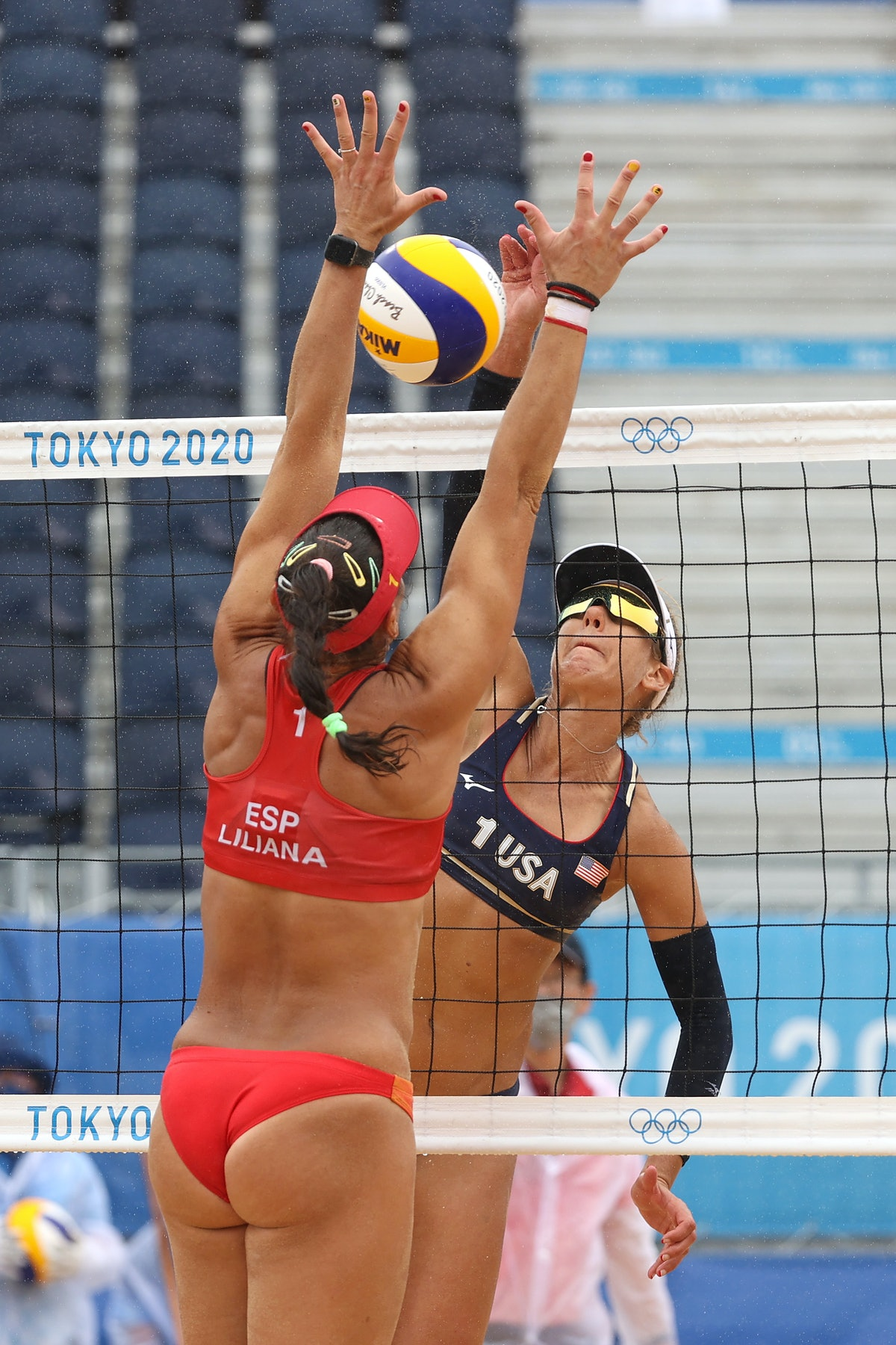 TOKYO, JAPAN - JULY 27: April Ross #1 of Team United States hits through the arms of Liliana Fernand...
