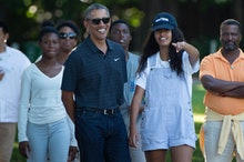 US President Barack Obama and his daughter Malia Obama walk during a visit to the Honolulu Zoo Janua...