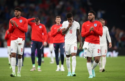 England's Tyrone Mings (left), Marcus Rashford (centre) and Reece James following defeat in the pena...