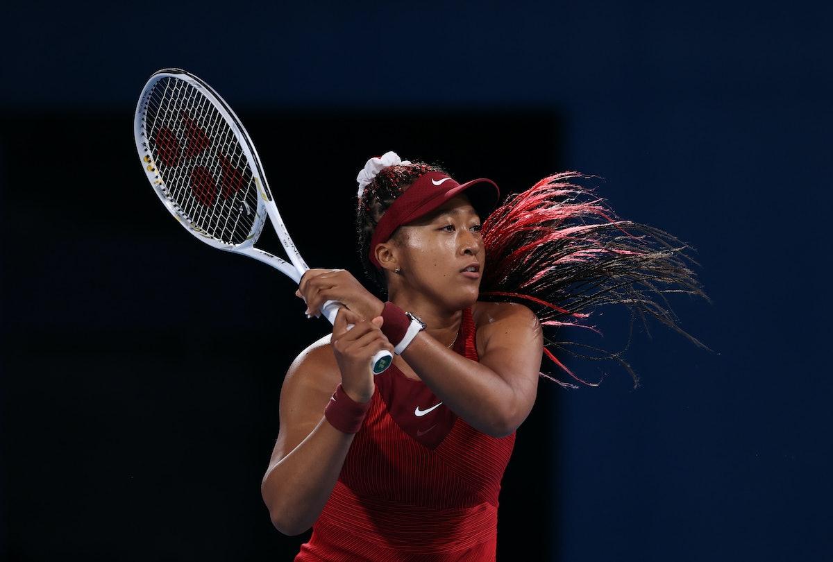 TOKYO, JAPAN - JULY 27: Naomi Osaka of Team Japan plays a backhand during her Women's Singles Third ...