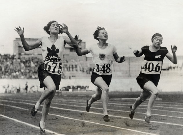 (Original Caption) The finish of the eight heat of the 100-meter dash for women won by Myrtle Cook (...