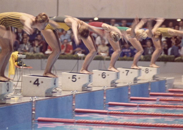 Start of women's 100 meter free style final.  Dawn Fraser of Australia, in lane #4 was the winner.  ...