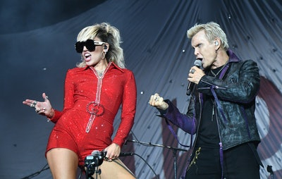 CHICAGO, ILLINOIS - JULY 29: Miley Cyrus and Billy Idol perform on stage during Lollapalooza 2021 at...