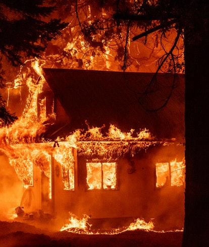 A home burns during the Dixie fire on July 24, 2021, in the Indian Falls neighborhood of unincorpora...