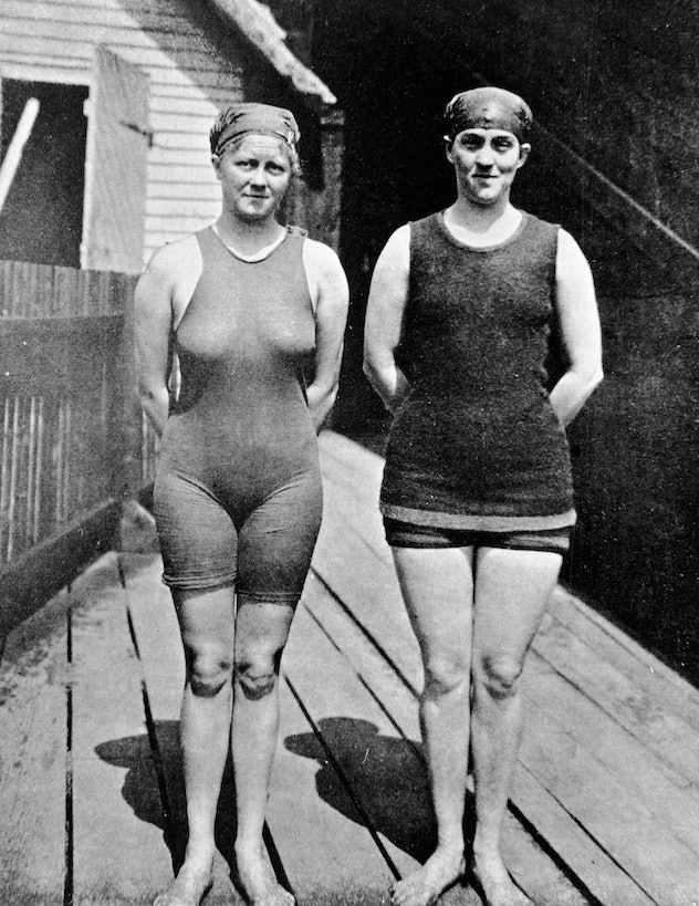 Australian swimmer Mina Wylie (1891 - 1984) (left) and Fanny Durack (1889 - 1956) pose together, han...