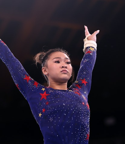 TOKYO, JAPAN - JULY 25: Sunisa Lee of Team United States reacts after competing on uneven bars durin...