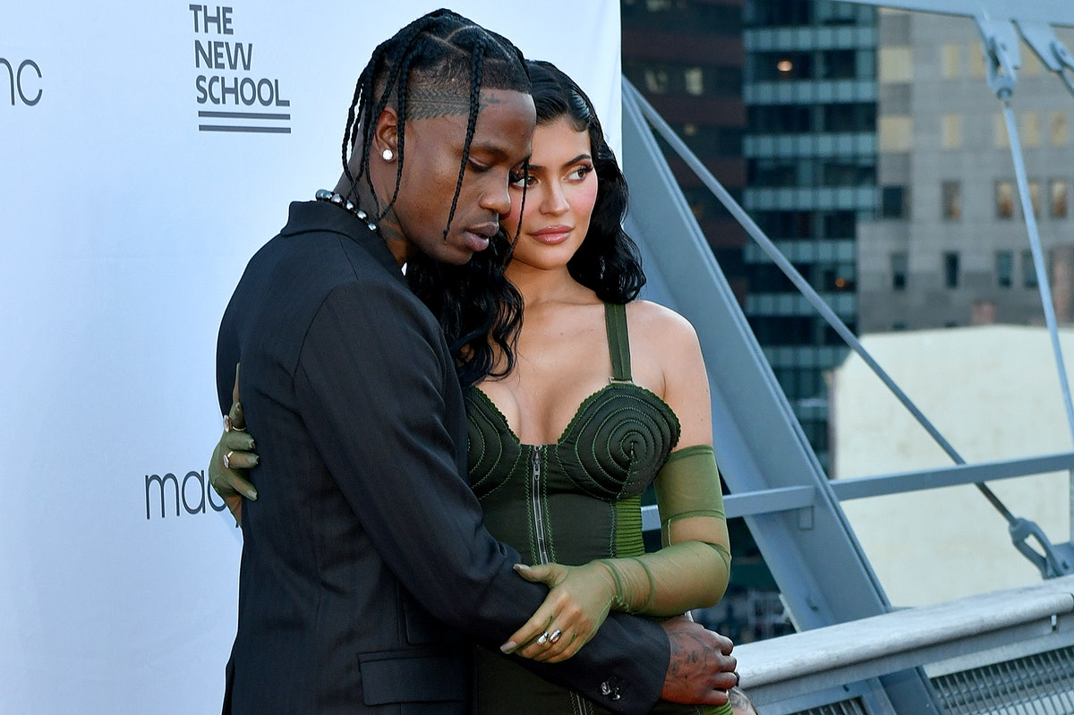 Kylie Jenner and Travis Scott on a red carpet.