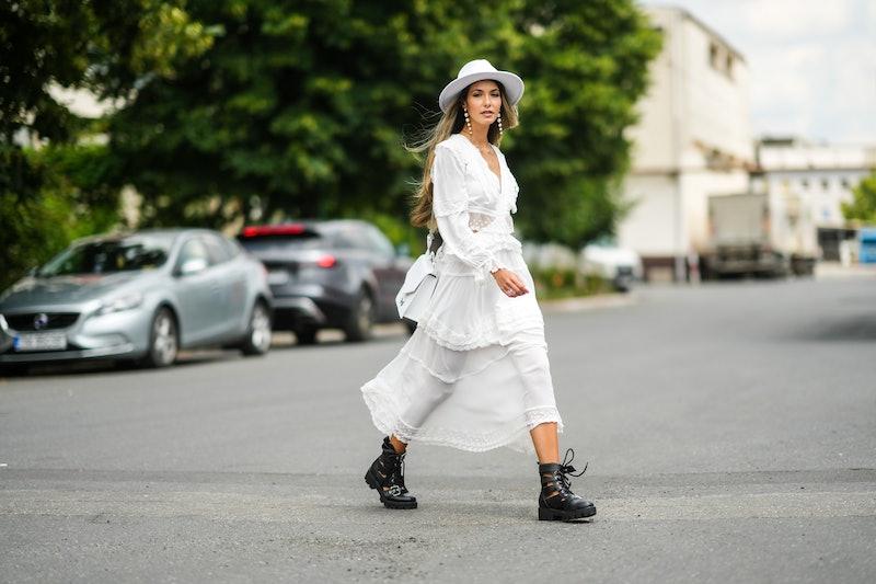 SIBIU, ROMANIA - JULY 24: Isabela Francesca wears a white felt / wool hat, white pearls pendant earr...
