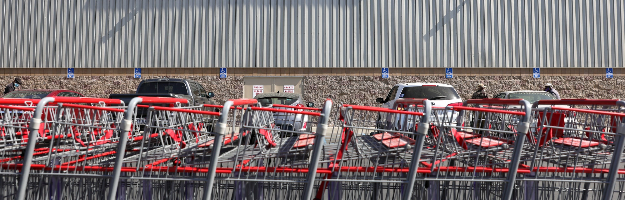 INGLEWOOD, CALIFORNIA - FEBRUARY 25: Shopping carts are lined up in front of a Costco store on Febru...