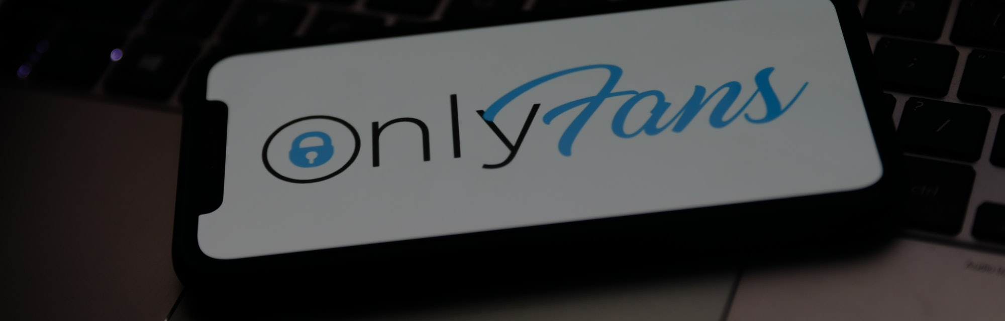 OnlyFans logo is seen displayed on a phone screen in this illustration photo taken in Krakow, Poland...