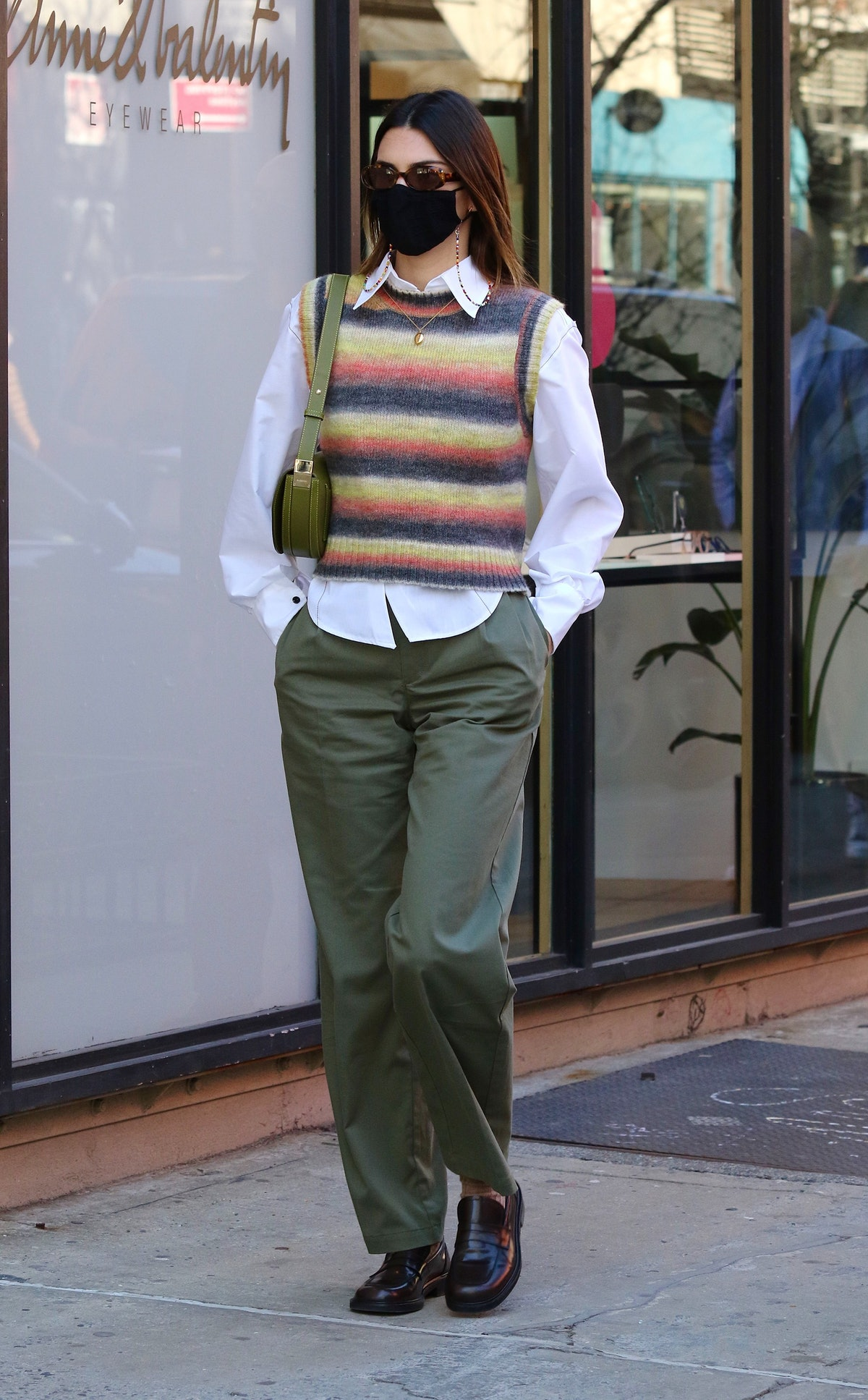 Model Kendall Jenner wears small green Burberry Olympia bag while out and about in New York City on ...