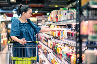 pregnant woman shopping for food