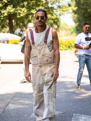 MILAN, ITALY - JUNE 18: Giotto Calendoli, wearing Carhartt beige dungarees, is seen in the streets o...