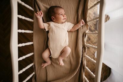 newborn baby in crib