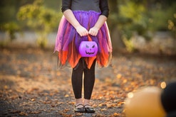 kid dressed as witch for halloween