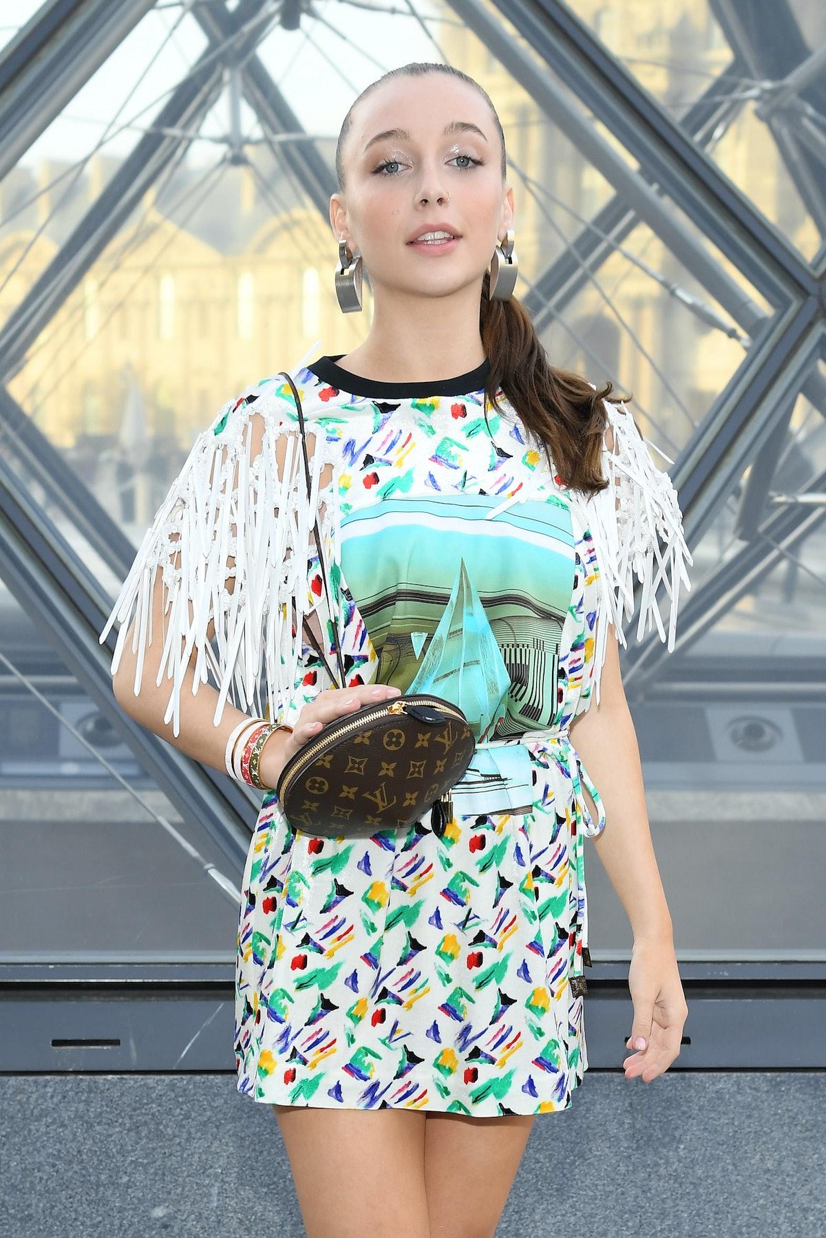 PARIS, FRANCE - MARCH 05: Emma Chamberlain attends the Louis Vuitton show as part of the Paris Fashi...