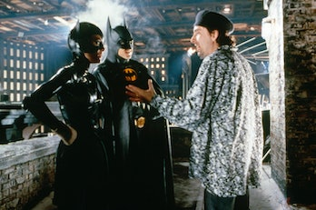 American actors Michelle Pfeiffer and Michael Keaton with director Tim Burton on the set of his movi...