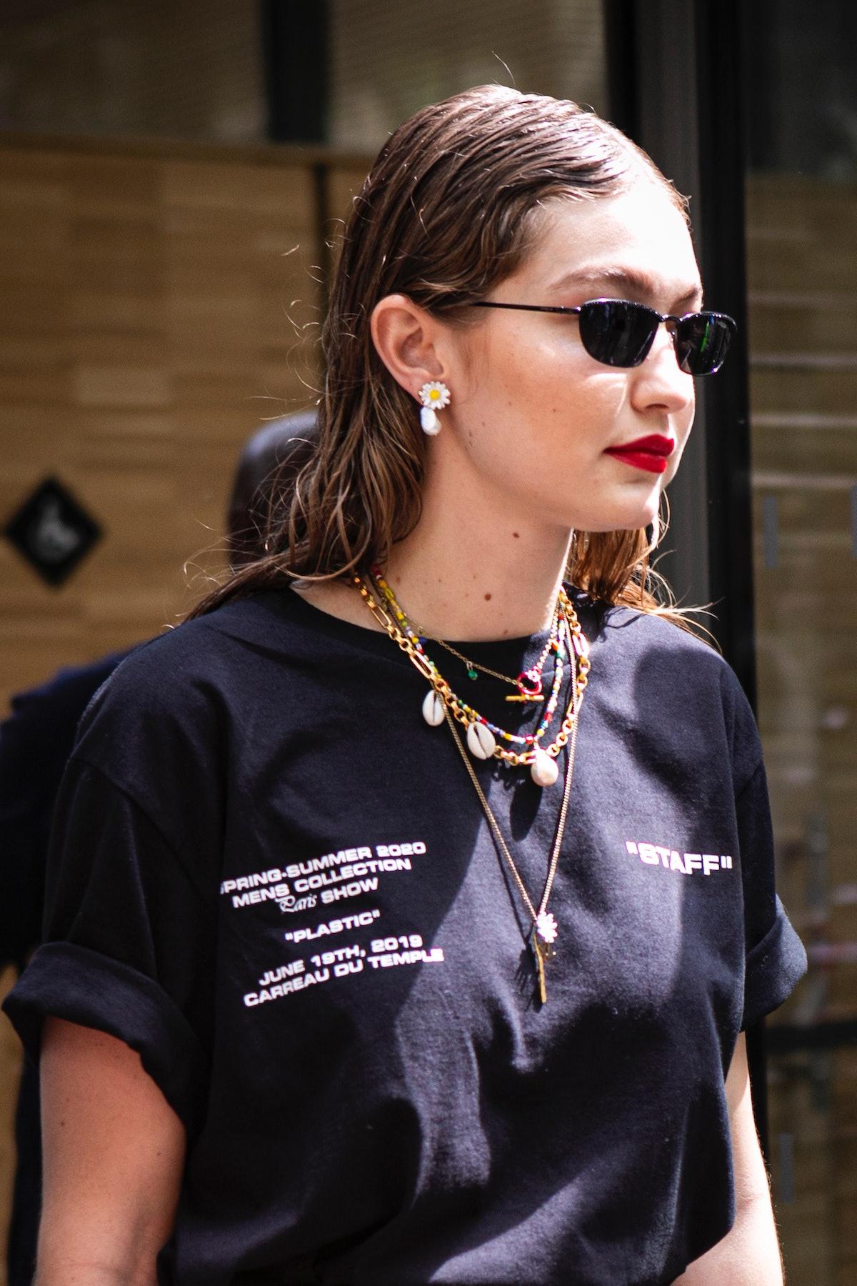 PARIS, FRANCE - JUNE 19: Gigi Hadid, wearing black sunglasses and black Off-White printed t-shirt, i...