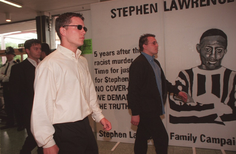 Three of the suspects tried in the Stephen Lawrence murder case walk past a Stephen Lawrence Family ...