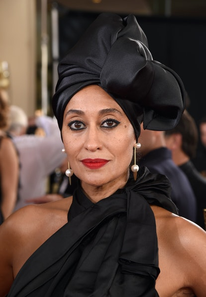 Tracee Ellis Ross wearing a signature blue-based red lipstick.