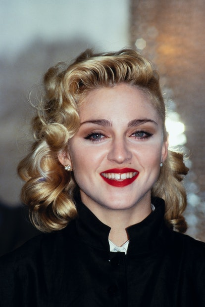 Madonna in a signature red lipstick in the '80s.