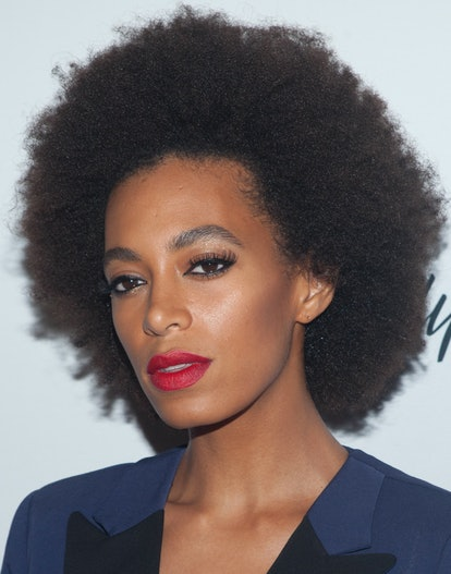 Solange Knowles in a pink-tinged red lipstick.