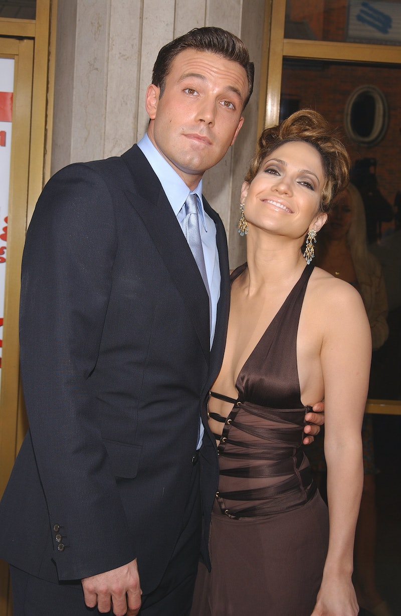 """Ben Affleck and Jennifer Lopez (dress by Gucci) arriving at the premiere of """"Gigli"""". (Photo by Frank..."""