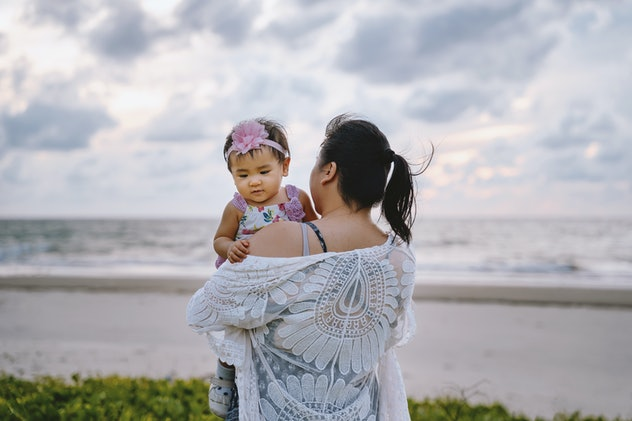 baby girl on beach with mom