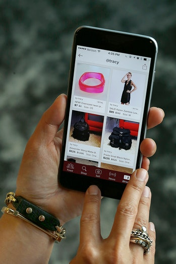 Poshmark co-founder Tracy Sun shows her app at her office in Redwood City, California, on friday, ma...