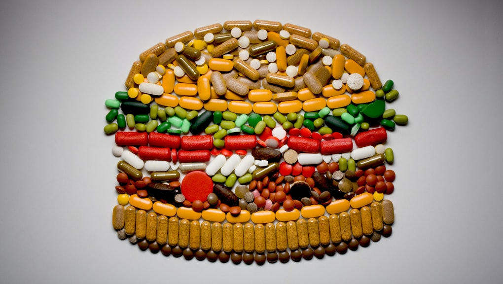 Burger made out of pills viewed from above