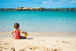 baby girl on a hawaii beach