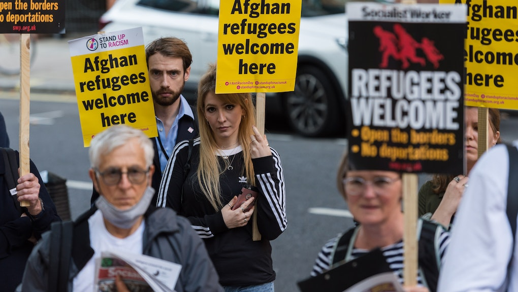 LONDON, UNITED KINGDOM - AUGUST 23, 2021: Demonstrators including Afghan people protest outside the ...