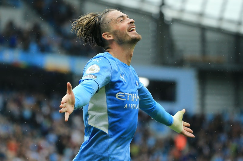 MANCHESTER, ENGLAND - AUGUST 21: Jack Grealish of Manchester City celebrates after scoring their sid...