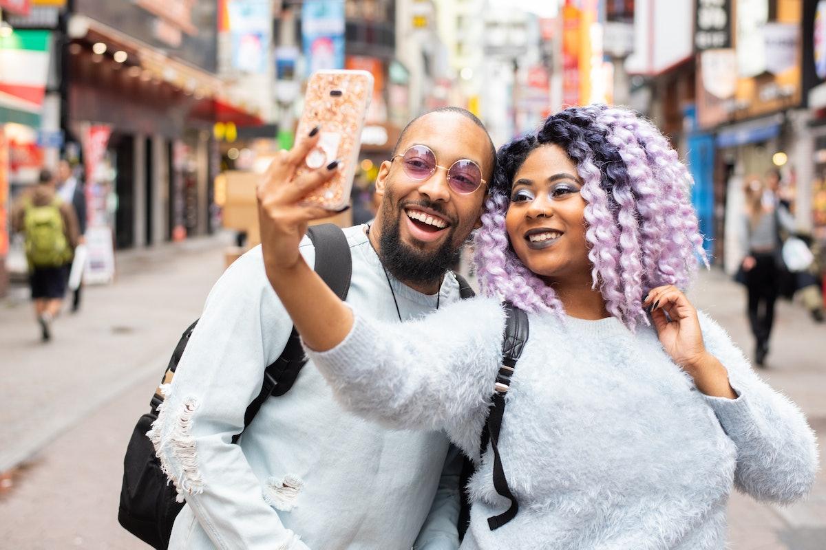 A Virgo woman and Scorpio man take a selfie.