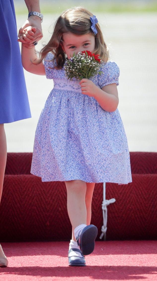 Princess Charlotte smells the roses.