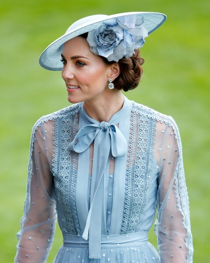 Kate Middleton's elegant bun is one of her greatest hairstyles. Catherine, Duchess of Cambridge atte...