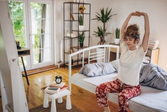 These 10 gentle stretches to do before you get out of bed will start your day off right.