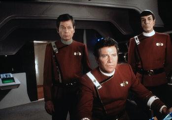 American actors DeForest Kelley, Leonard Nimoy and Canadian William Shatner on the set of Star Trek:...