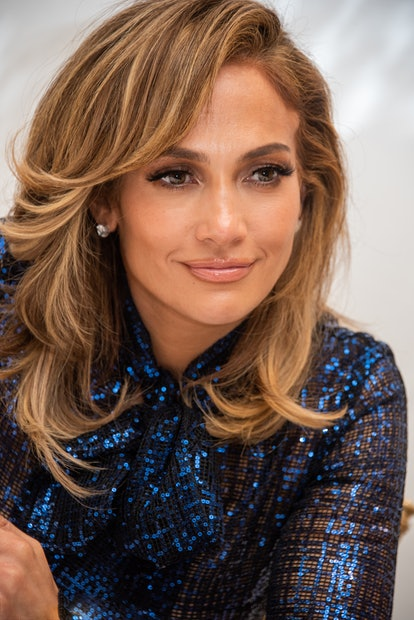 Jennifer Lopez wears side-swept curtain bangs with her ends curled.