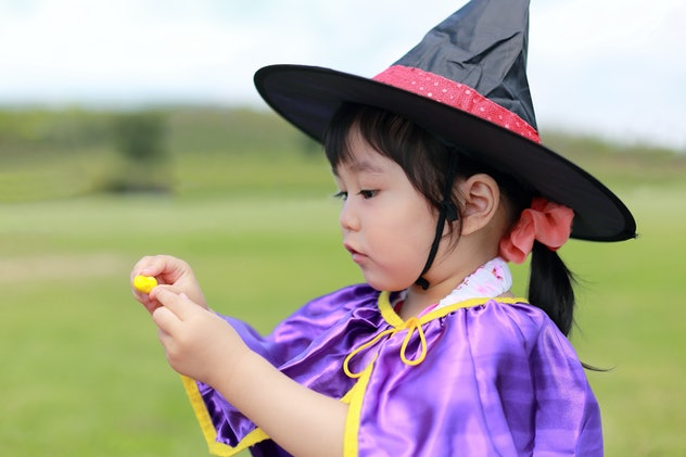 little girl dressed up like a witch for halloween