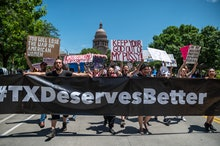 AUSTIN, TX - MAY 29: Pro choice protesters march down Congress Avenue at a protest outside the Texas...