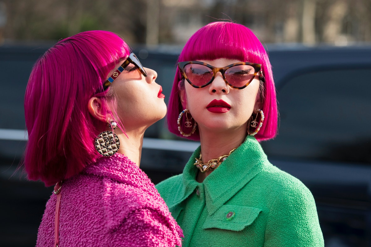 PARIS, FRANCE - MARCH 03: Musical Artists Aya Suzuki and Ami Suzuki from music duo Amiaya wear all C...