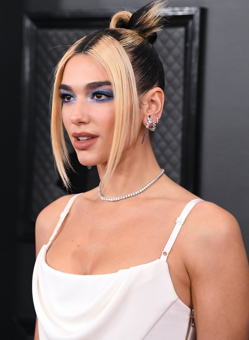 Dua Lipa rocks the two tone hair color trend. Here, pro colorists give their tips for the look.