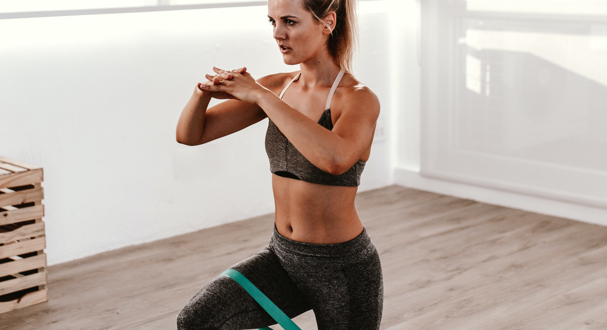 Trainers share their favorite resistance band exercises for strengthening the glutes.